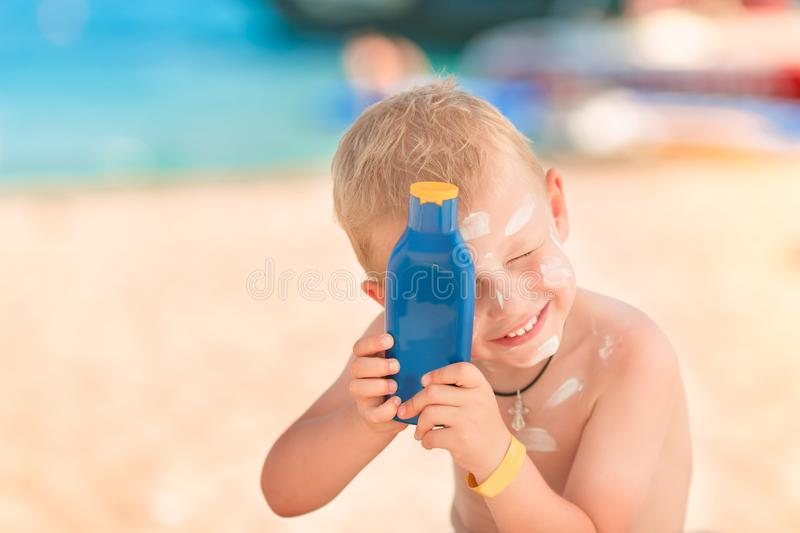 Cute little boy with sunscreen on royalty free stock images