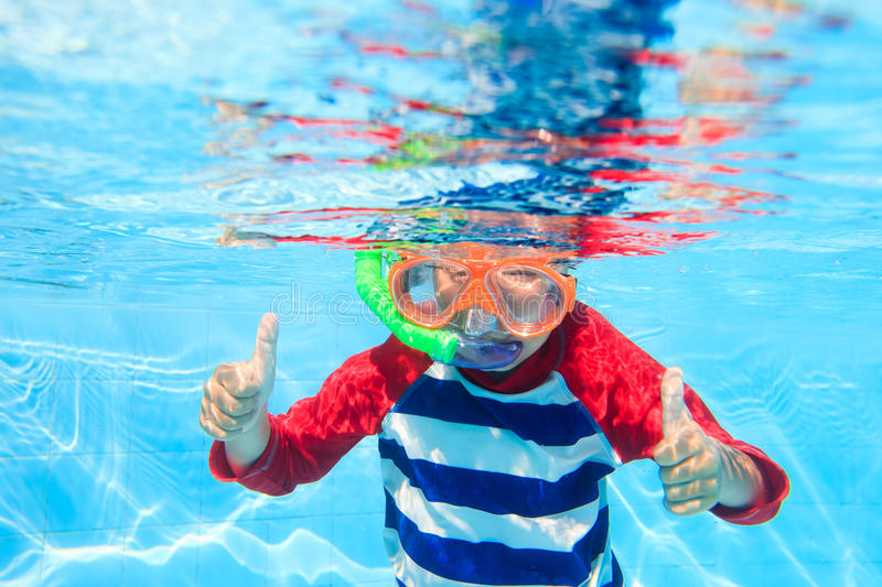 Cute little boy swimming underwater royalty free stock photo