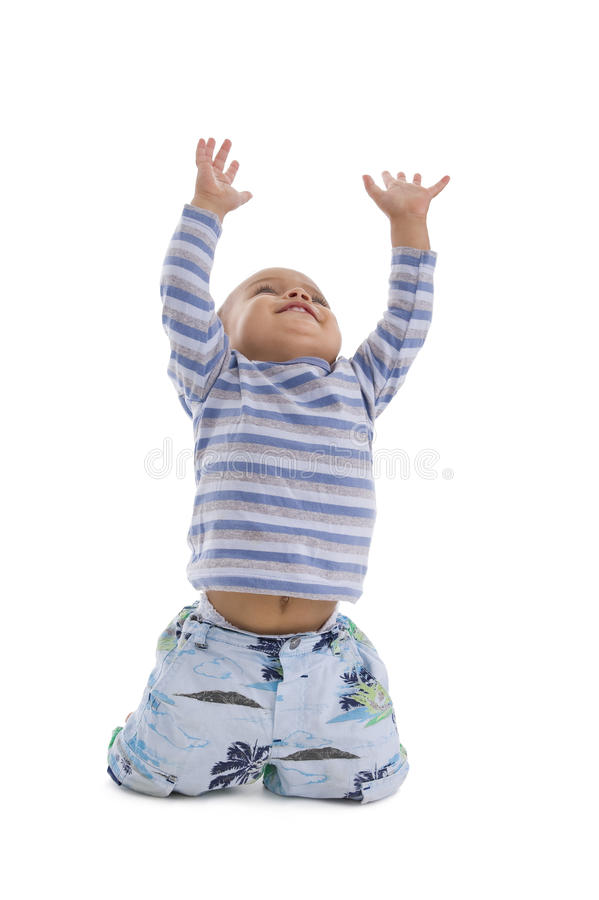 Cute little boy trying to catch something royalty free stock photos