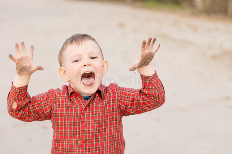Cute Little Boy Trying To Scare The Viewer Stock Photo