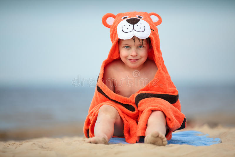 Cute little boy wearing tiger towel outdoors stock image