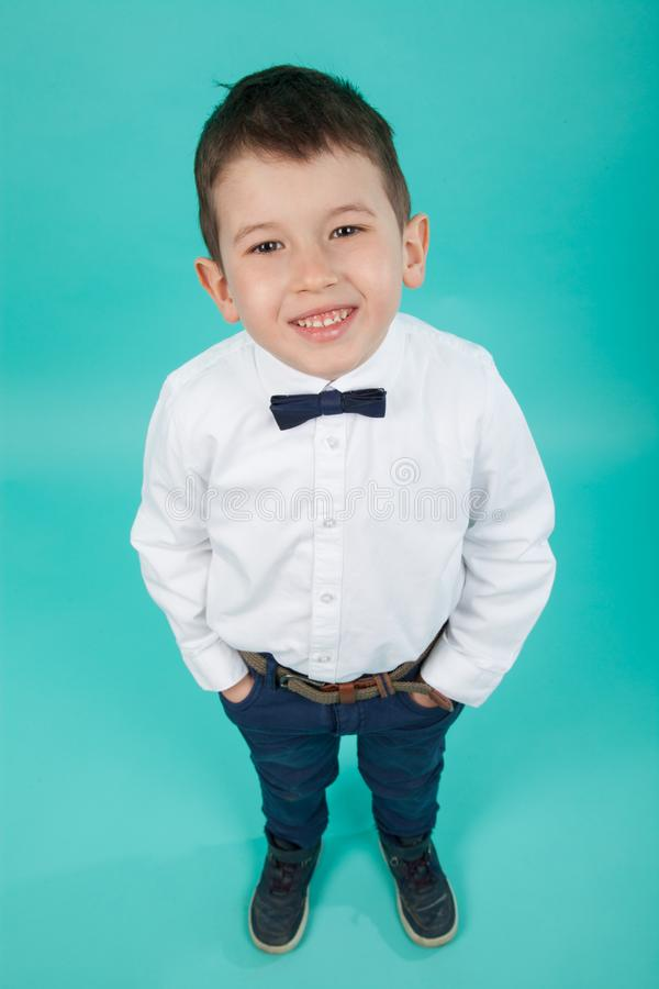 Cute little boy with white shirt and bow tie. Elegant little gentleman royalty free stock photography