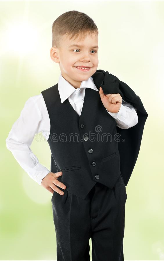 Cute little boy in a white shirt and suit royalty free stock photography