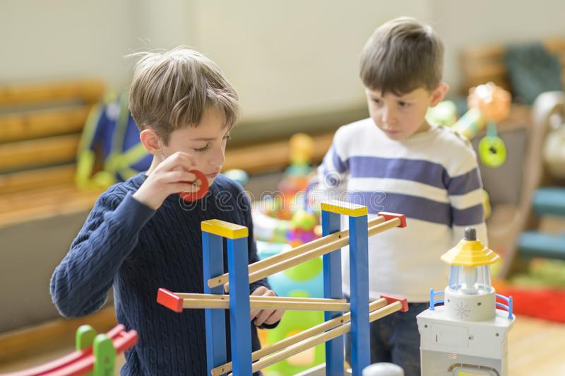 Cute Little Boys Playing at Kindergarten stock images