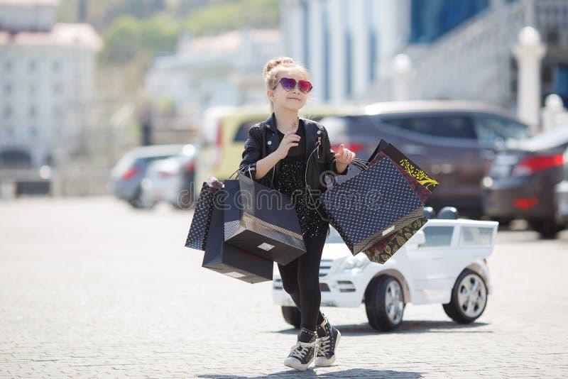 Cute little caucasian girl child having shopping fun. stock images