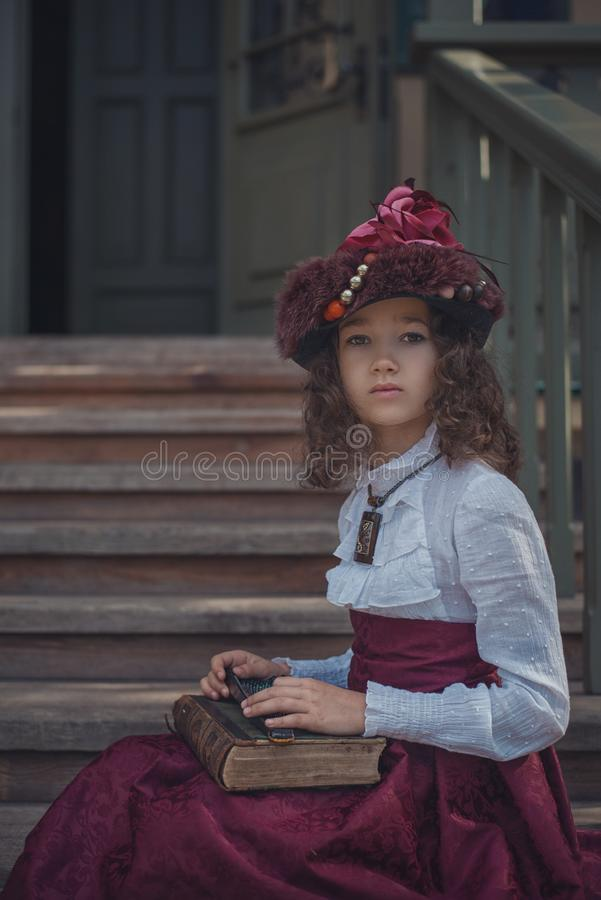 Cute little caucasian girl wearing retro clothes. Nice female child in beautiful vintage dress. stock image