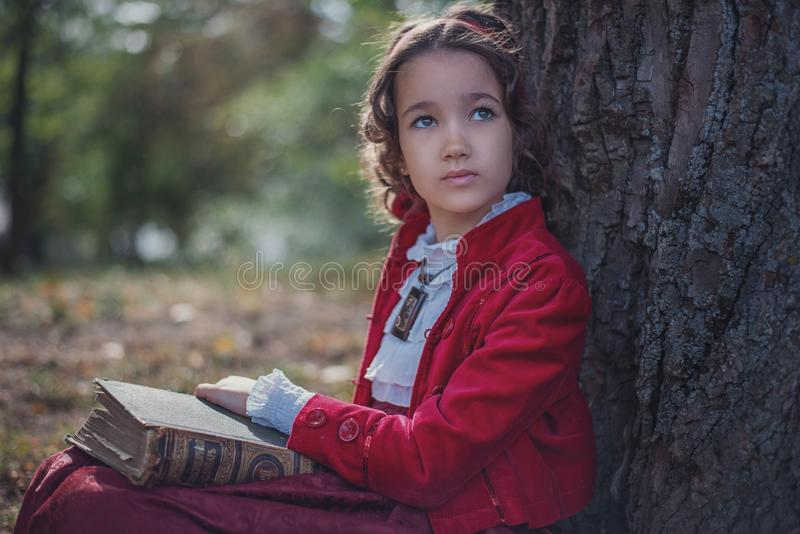Cute little caucasian girl wearing retro clothes. Nice female child in beautiful vintage dress. royalty free stock photo