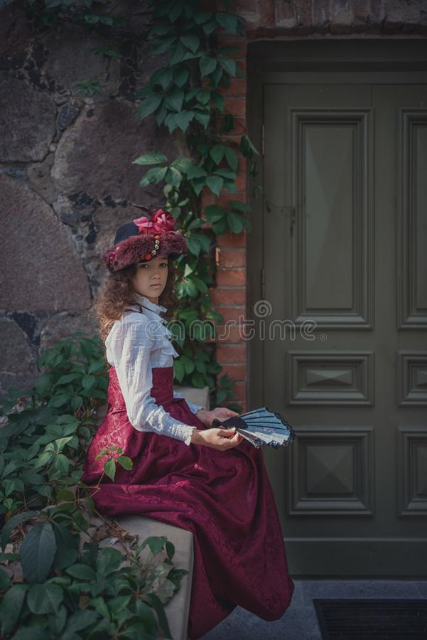 Cute little caucasian girl wearing retro clothes. Nice female child in beautiful vintage dress. stock images