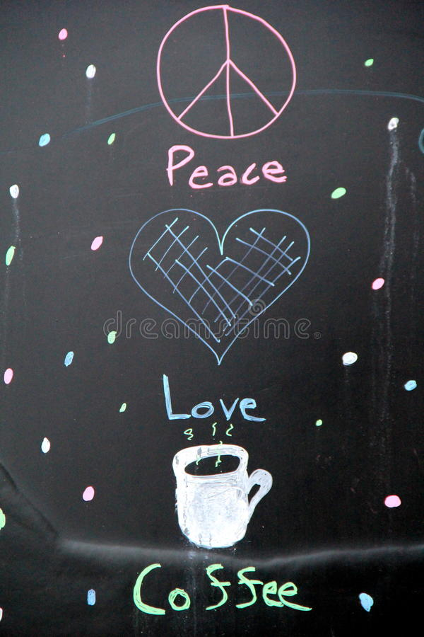 Cute little chalkboard sign with a peace sign, heart and coffee cup stock images