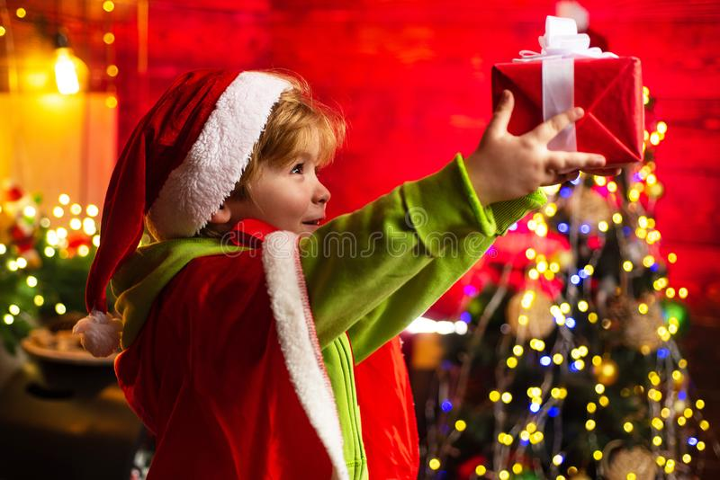 Cute little child boy play near christmas tree. Kid enjoy winter holiday at home. Home filled with joy and love. Merry stock image