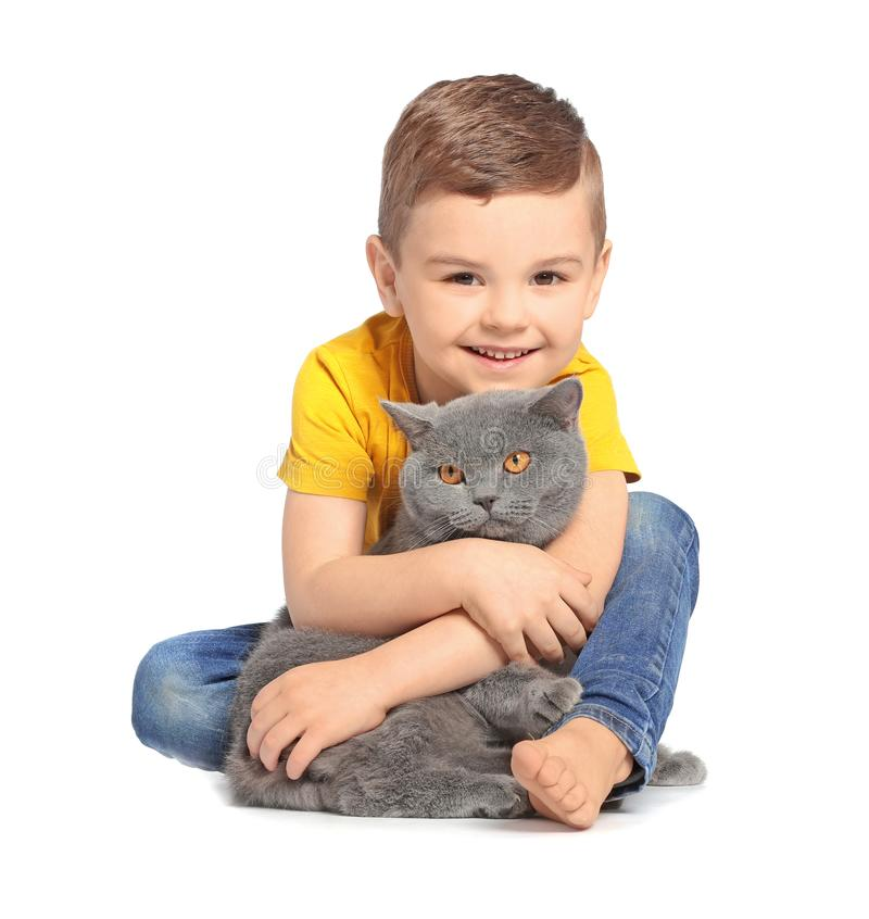Cute little child with cat. On white background stock image