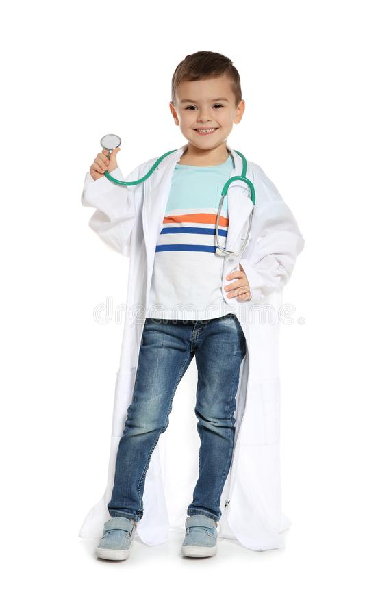 Cute little child in doctor coat with stethoscope on white. Background royalty free stock photo
