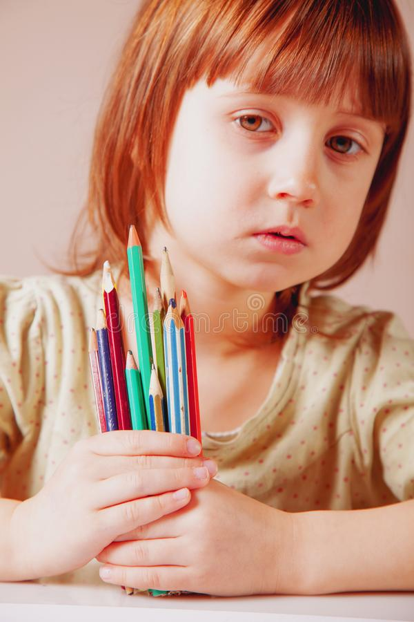 Cute little child girl with colored pencils. Art, creative, talent, education,  happy childhood concept royalty free stock photography