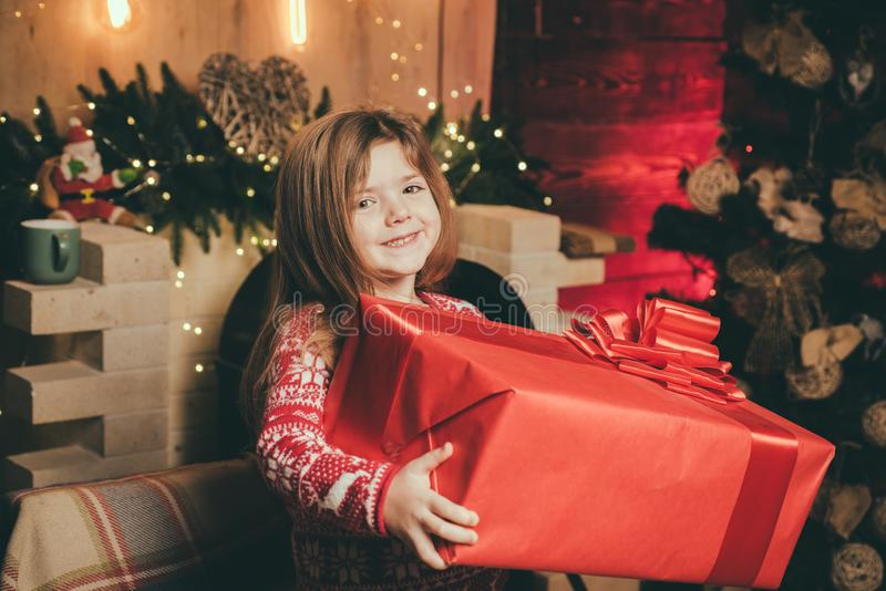 Cute little child girl play near christmas tree. Kid enjoy winter holiday at home. Home filled with joy and love. Merry stock images