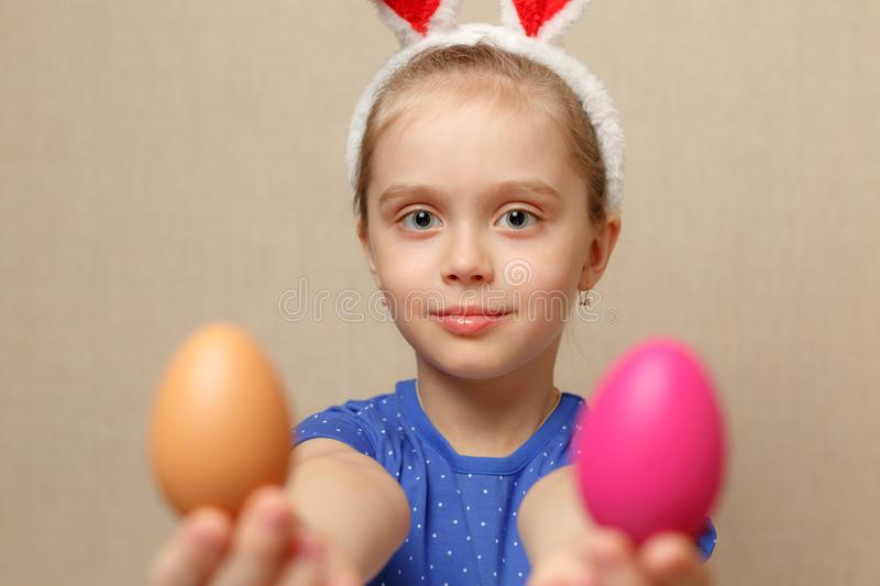 Cute little child girl wearing bunny ears on Easter day. royalty free stock images