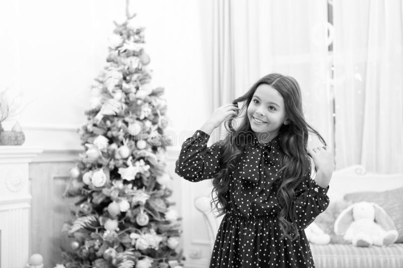 Cute little child girl with xmas present. The morning before Xmas. christmas family holiday. happy new year. Christmas. Shopping. waiting for santa. Winter royalty free stock photography