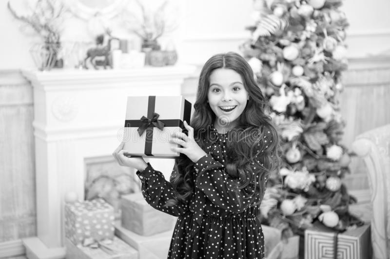 Cute little child girl with xmas present. The morning before Xmas. christmas family holiday. happy new year. Christmas royalty free stock image