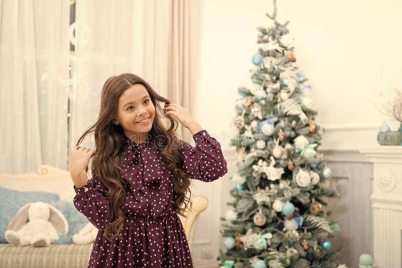 Cute little child girl with xmas present. The morning before Xmas. christmas family holiday. happy new year. Christmas. Shopping. waiting for santa. Winter stock photo