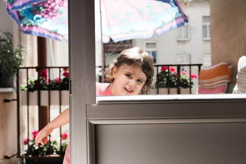 Charming little girl smiling and playing royalty free stock photos