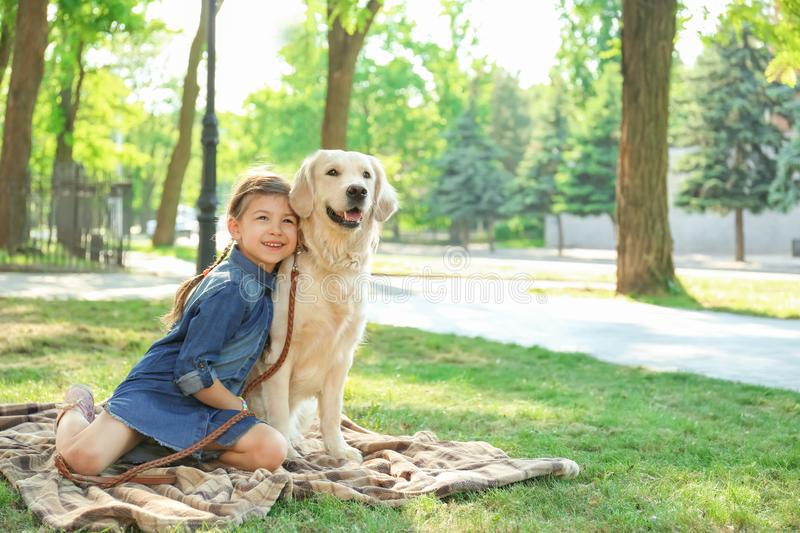 Cute little child with her pet in green park stock photos