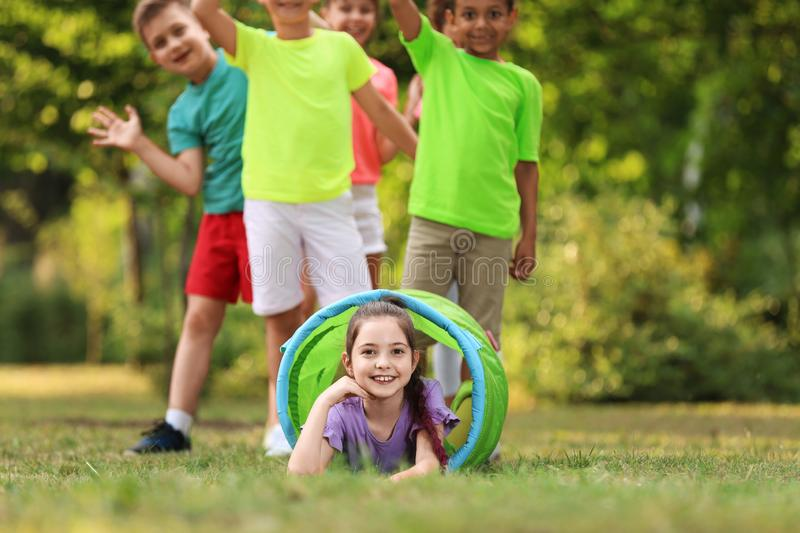 Cute little child playing with friends royalty free stock images