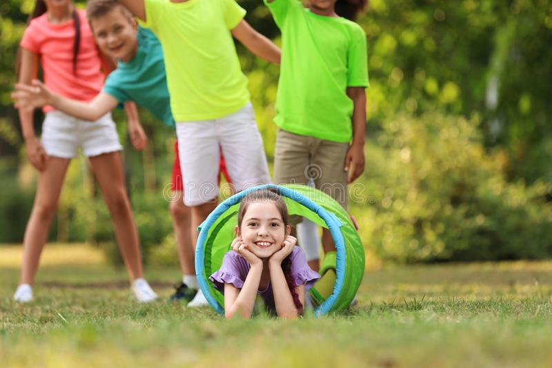 Cute little child playing with friends stock photo