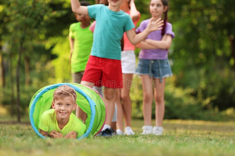 Cute little child playing with friends in park stock photo