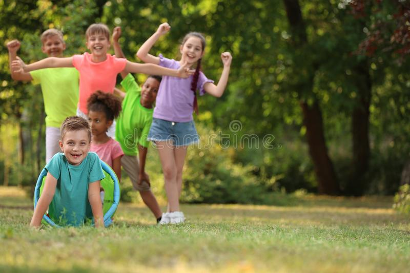 Cute little child playing with friends in park stock images