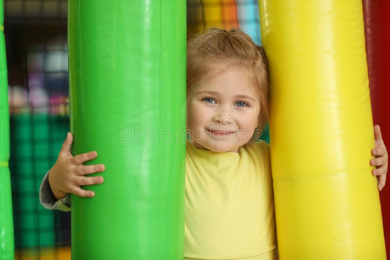 Cute little child playing at amusement park royalty free stock image