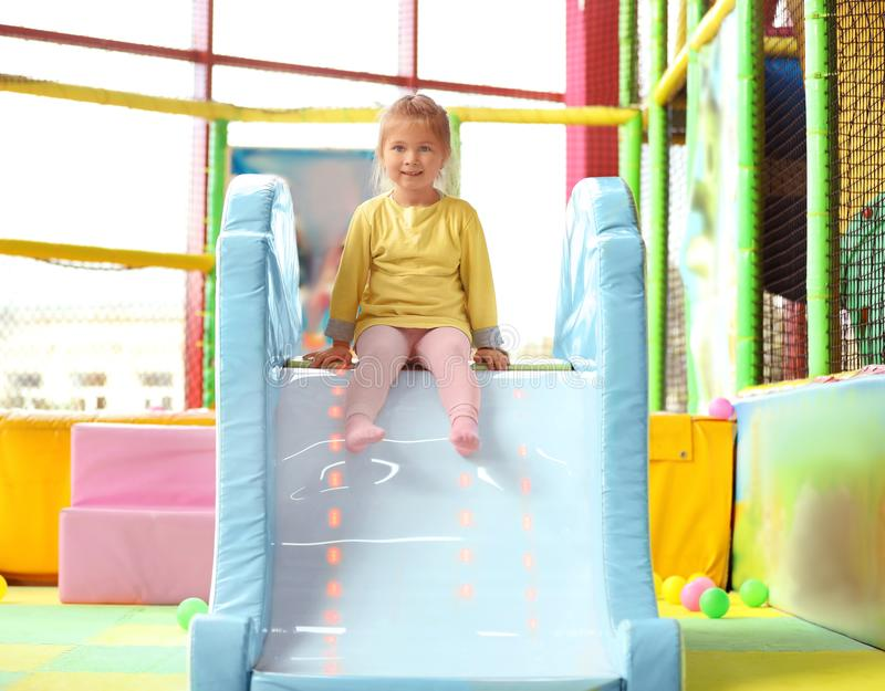 Cute little child playing at amusement park stock photos