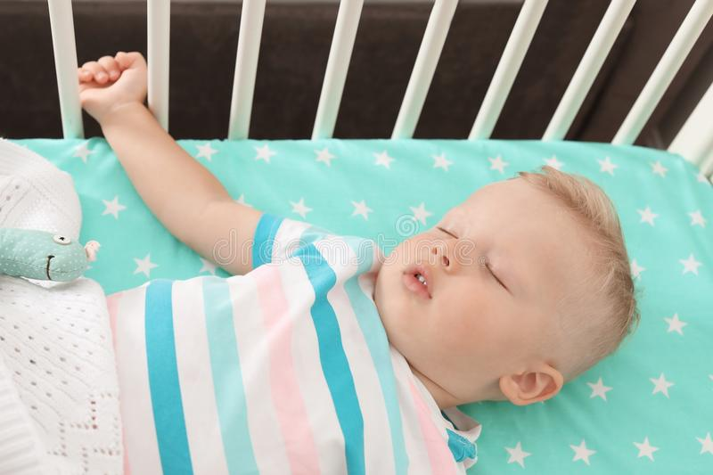 Cute little child sleeping in crib. At home royalty free stock photography