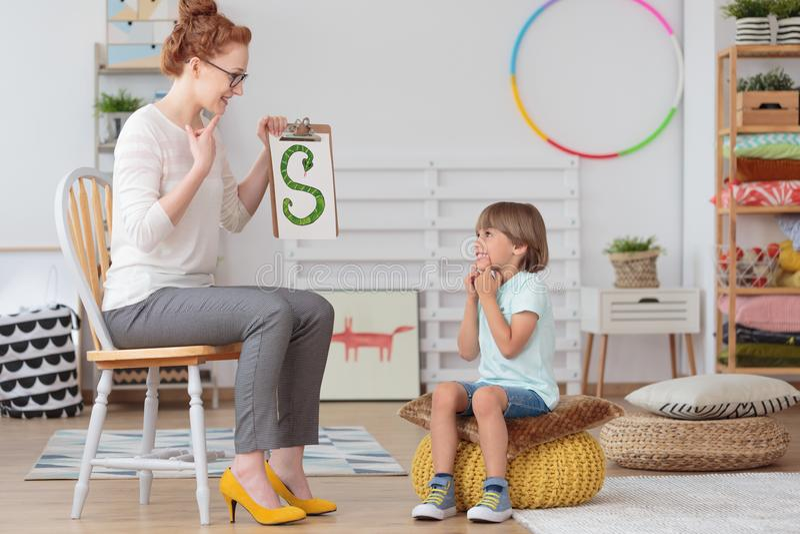 Child and teacher in kindergarten stock photos