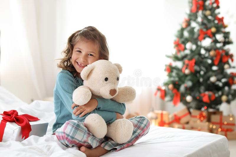 Cute little child with toy bear and Christmas gift box royalty free stock photography
