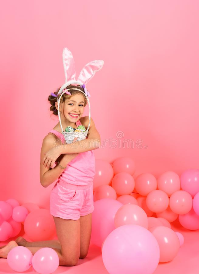 Cute little child wearing bunny ears on Easter day. stock image