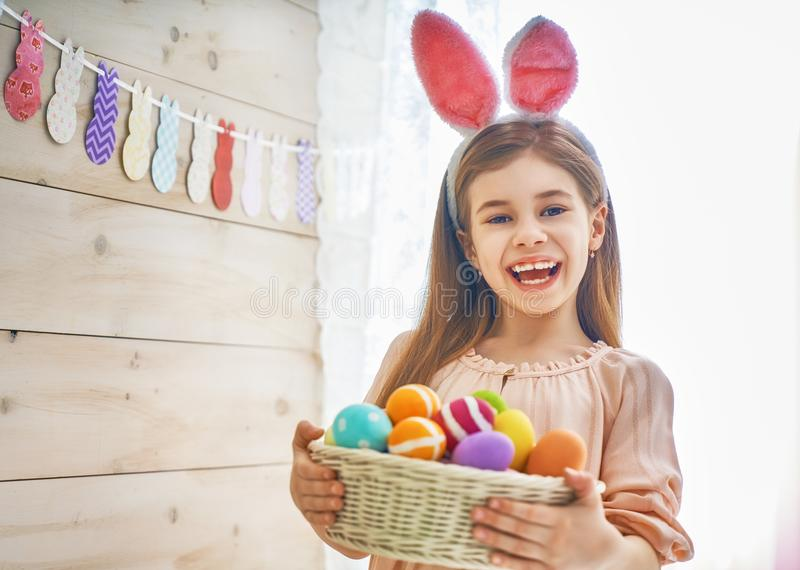 Girl holding basket with painted eggs royalty free stock photo