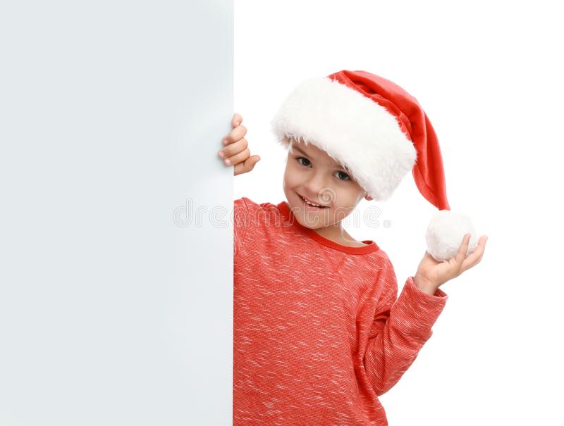 Cute little child wearing Santa hat. Christmas holiday royalty free stock image
