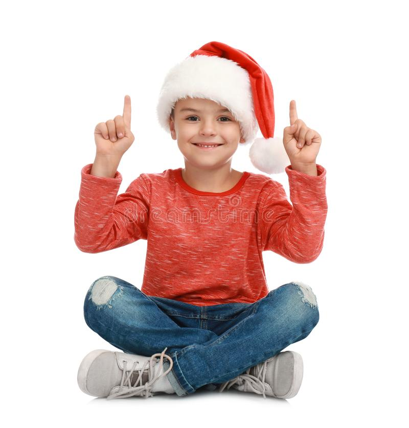 Cute little child wearing Santa hat on white. Christmas holiday stock photography