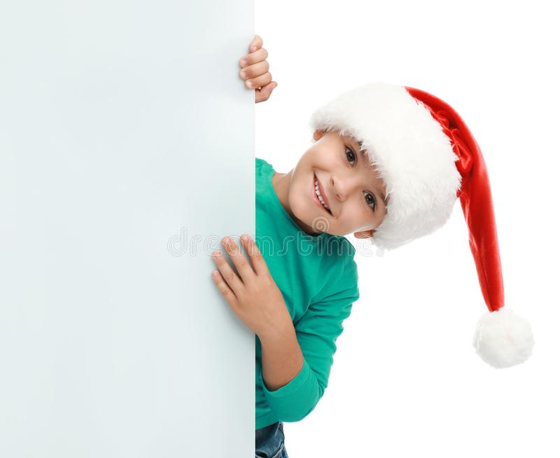 Cute little child wearing Santa hat on white background stock photo