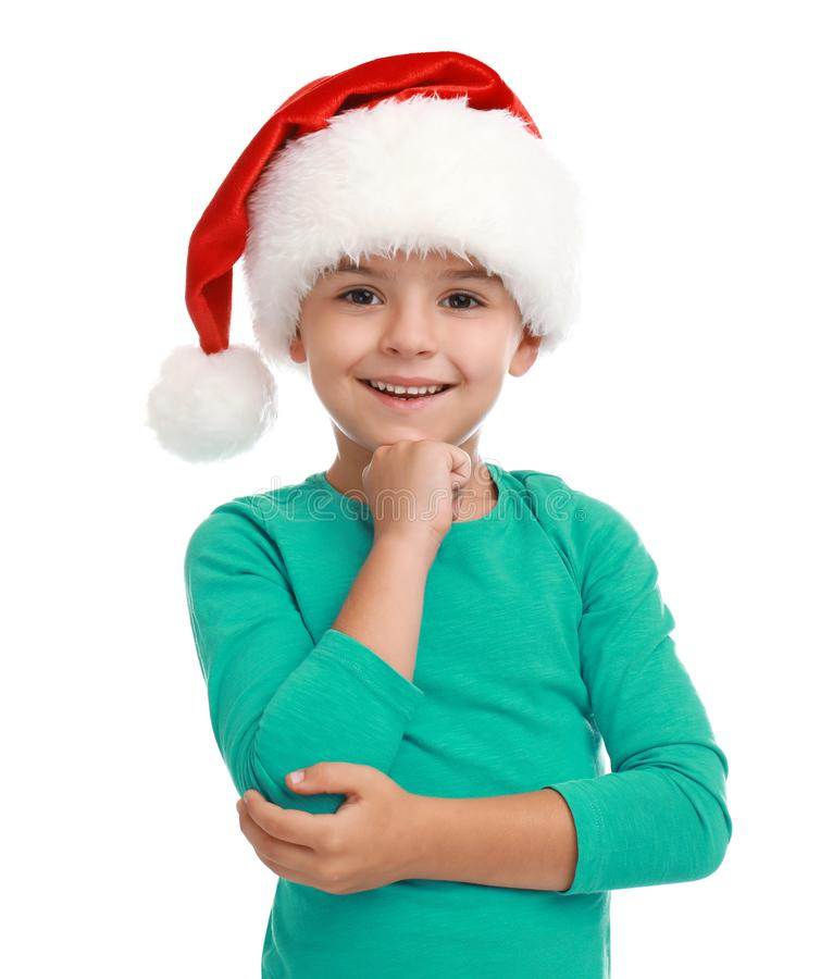 Cute little child wearing Santa hat on white background stock photography