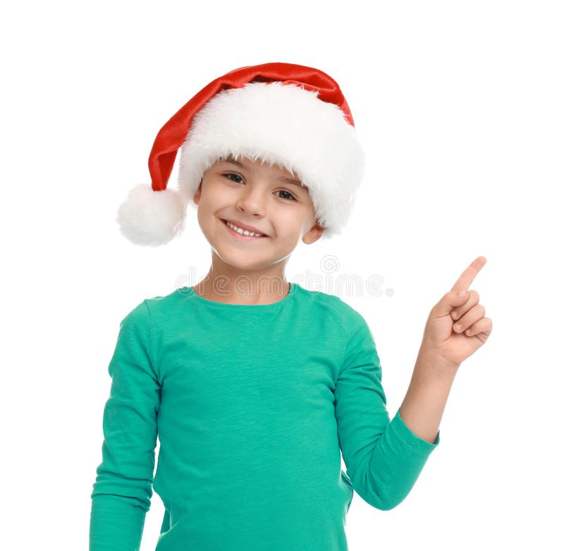 Cute little child wearing Santa hat on white. Christmas holiday stock image
