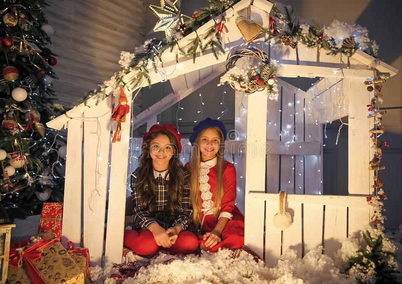 Cute little children girl with xmas present. happy little girls sisters celebrate winter holiday. christmas time. happy. New year. delivery christmas gifts stock photos