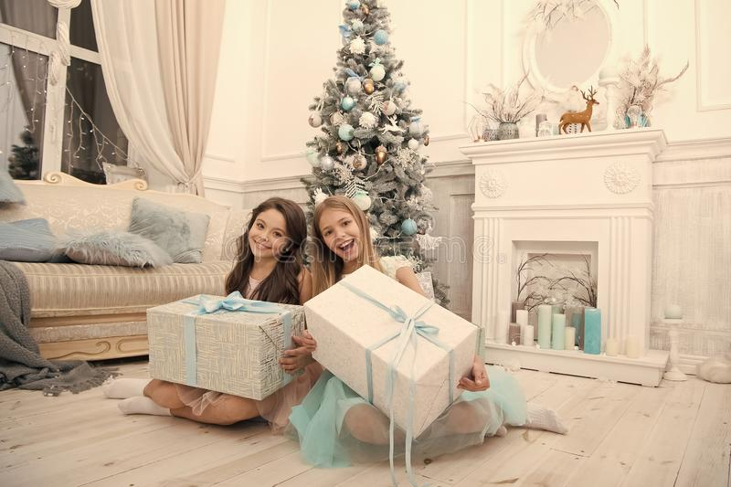 Cute little children girl with xmas present. happy little girls sisters celebrate winter holiday. christmas time. happy. New year. delivery christmas gifts stock images