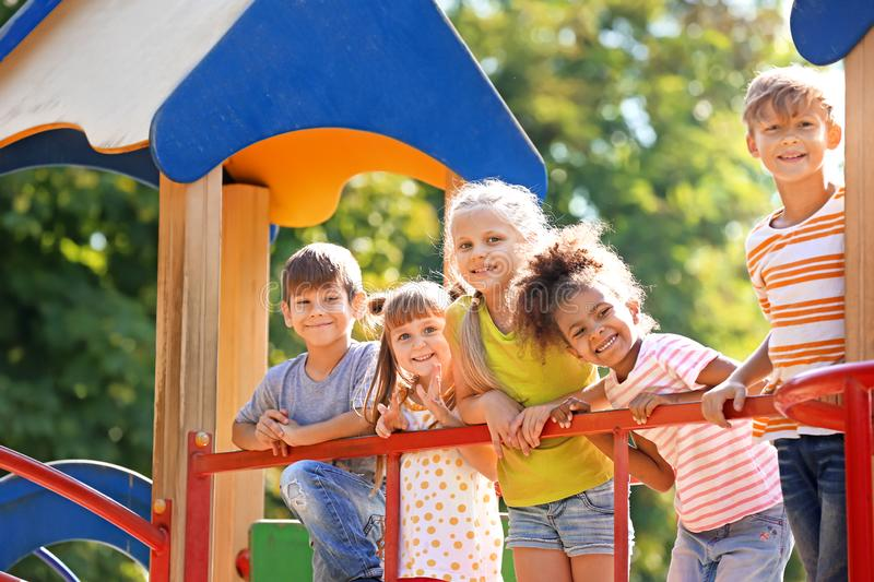 Cute little children having fun on playground outdoors royalty free stock photography