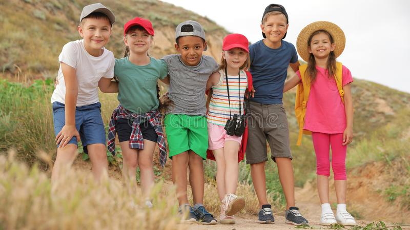 Cute little children outdoors on summer day royalty free stock image