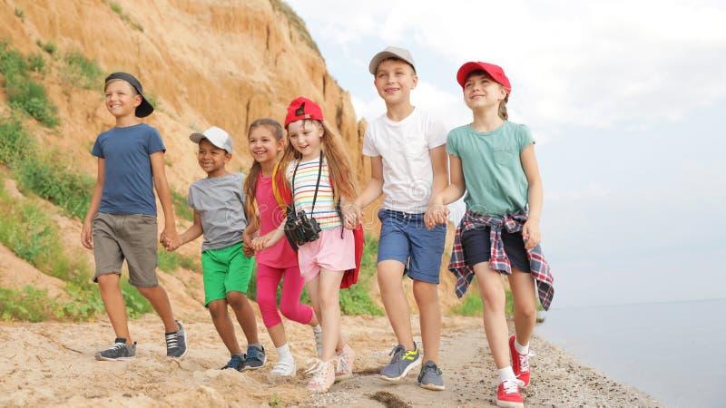Cute little children outdoors on summer day stock photos