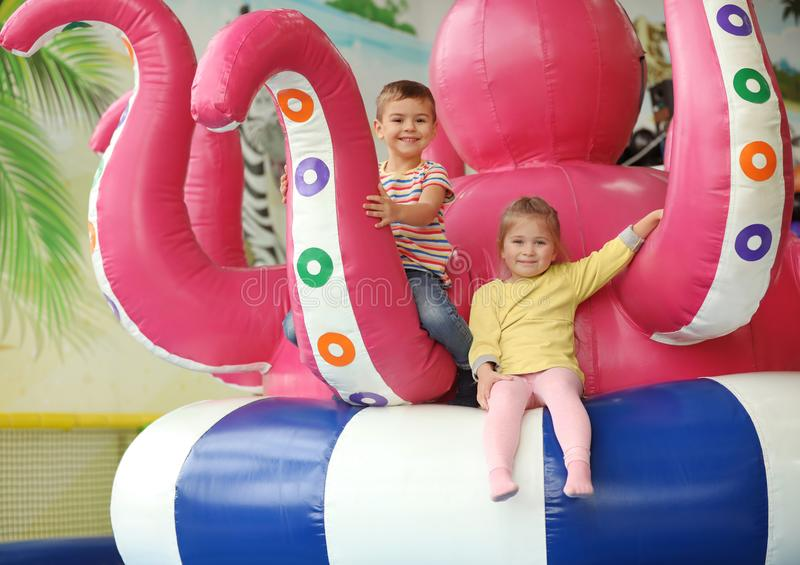 Cute little children playing at amusement park royalty free stock photo