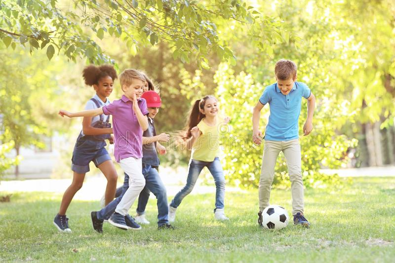 Cute little children playing with ball outdoors stock photo