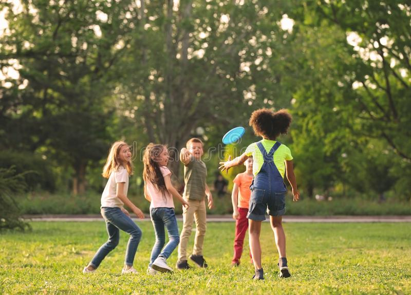 Cute little children playing with frisbee outdoors royalty free stock images