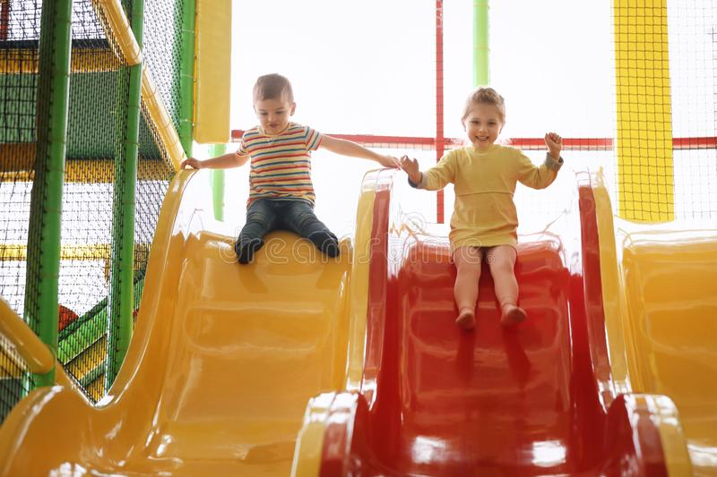 Cute little children playing at indoor park royalty free stock images