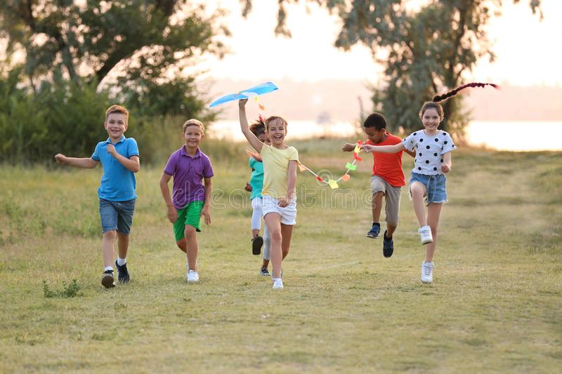 Cute little children playing with kite stock photo